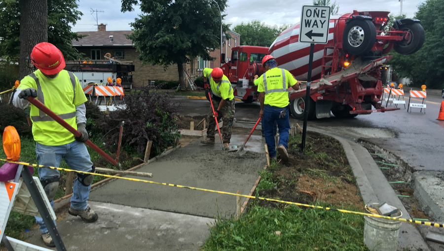 Rabine Paving Crew working on Concrete Sidewalk for a MidWest Paving Project on Utilities